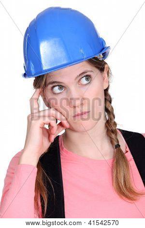 Pensive tradeswoman