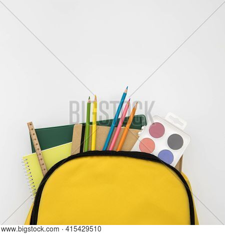 Open Knapsack With School Accessories . High Quality And Resolution Beautiful Photo Concept