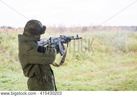 Man Shooting At A Target. Unformal Shooting Range