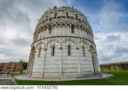 View Of The Pisa Baptistery On Piazza Dei Miracoli In Pisa, Tuscany, Italy. Rear View