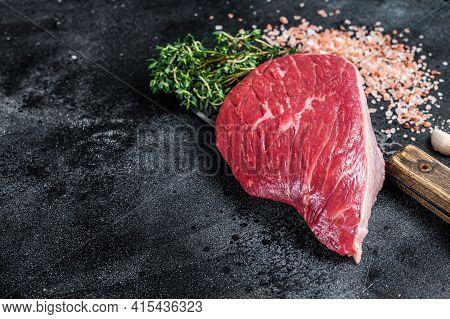 Fresh Raw Rump Beef Cut Or Top Sirloin Cap Steak On Butcher Cleaver. Black Background. Top View. Cop