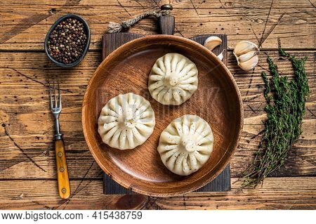 Boiled Khinkali Dumplings With Mutton Lamb Meat In Wooden Plate. Wooden Background. Top View