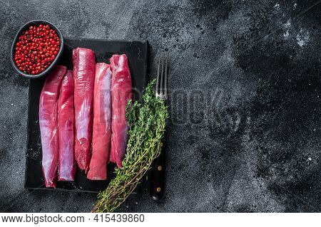 Fresh Raw Lamb Tenderloin Fillet, Mutton Sirloin Meat On Marble Board With Thyme. Black Background.