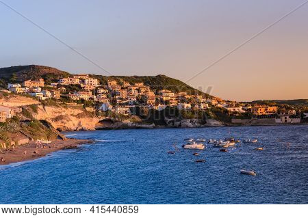 Panoramic View Of The Village In The Rocks And Beach,boats At Sea Of The Island Of Sardinia.north Of
