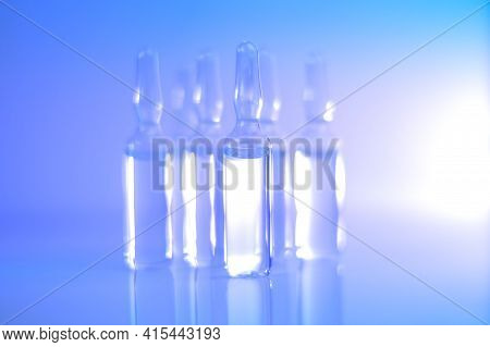 Medicine And Pharmacology.biotechnology And Science. Transparent Ampoules Set In Light Blue And Purp