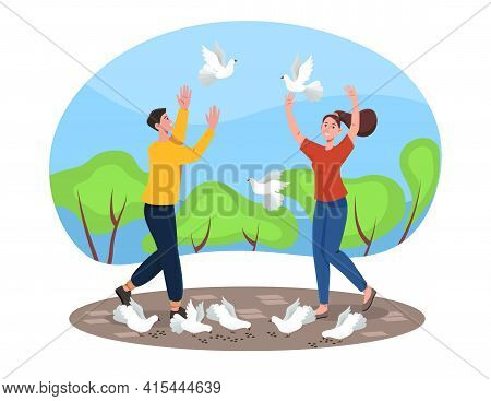 Lovers Couple Walking Park And Feed White Pigeons. Healthy Active Lifestyle. Enamored People Celebra