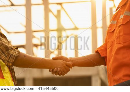 The Contractor And The Supervisor Shook Hands After Inspecting The Site,