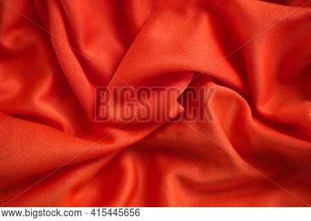 Red Crumpled Fabric Texture Background. Close Up.