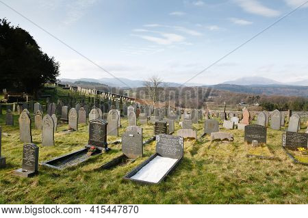 Conwy, Wales - March 02, 2012. Graves In A Graveyard Or Cemetery In Snowdonia Landscape. Capel Garmo