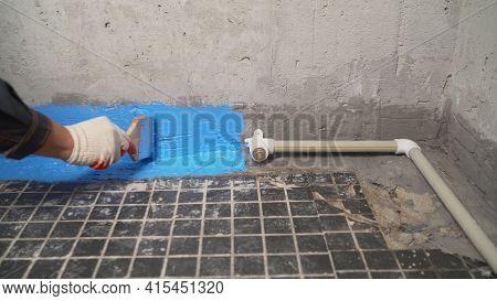 Waterproofing Paint. Floor Waterproofing. Applying Blue Waterproofing In The Bathroom.