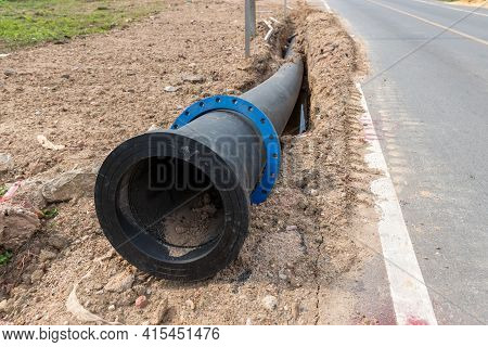 Construction Site With New Water Pipes In The Ground. Sewer Pipes To Repair Or Restore In Street Cit