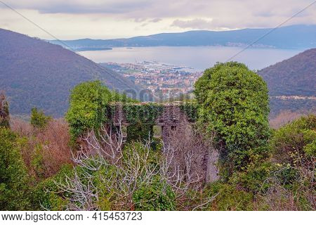 Cloudy Day. Old Ruined House In Mountains Against Beautiful Mediterranean Landscape. View Of Tivat C