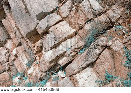Blue Grass Among Large Stones, Unreal Stone Background