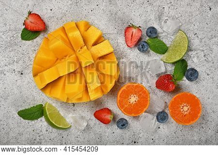 Close Up Preparing Fresh Ripe Cut Mango And Mixed Fruits Dessert On Gray Stone Cutting Board, Elevat