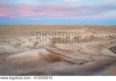 dawn over badlands in Pawnee National Grassland in northern Colorado, early spring scenery, aerial view of Main Draw OHV Area