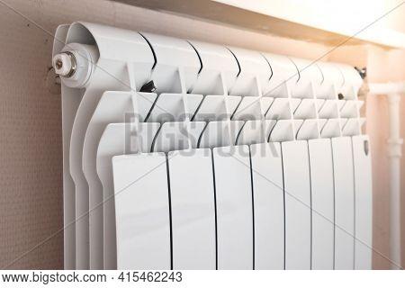 Close-up Of Modern Home Heating Radiator Under The Window. Bimetal, Aluminium Radiator. Heating Syst