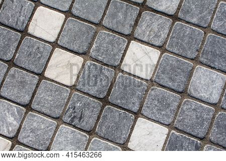 Weathered Wall Background. Old Dirty Wall Covered With Thin Ceramic Square Tiles. White Gray Light B