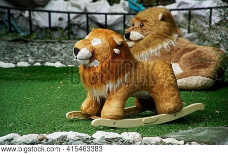 Discarded Old Toys Are Placed On The City Lawn. Vintage Plush Lions. Participation Of Residents In T