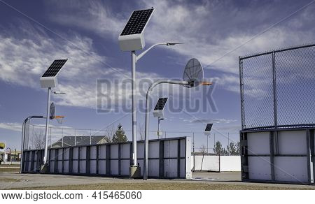 Solar Powered Street Lights Recharge In The Daylight At An Outdoor Recreation Court In Airdrie Alber