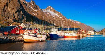 Norway Landscape, Fishing boats in fjord at midnight sun in Lofoten Islands, Ramberg, Norway