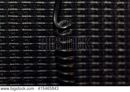 Black Coiled Cable With A Little Dust . Details Of Headphone Wire