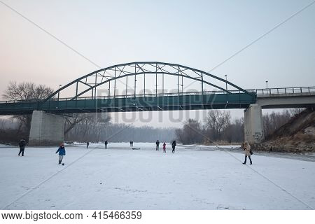 Pancevo, Serbia - January 22, 2017: People, Mainly Children Playing And Walking On Frozen Timis Tami