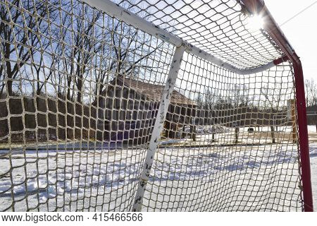 Ice Hockey Rink In The Park In Winter With Lens Flare