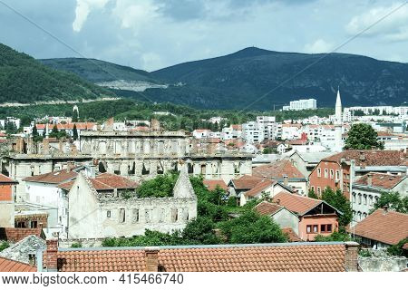 Panorama Of Mostar, In Bosnia And Herzegovina, Seen From Above, With A Focus On War Damaged Building
