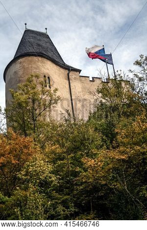 Czech Flag Waiving On Main Medieval Dungeon Of Hrad Karlstejn Castle During An Autumn Afternoon. Kar