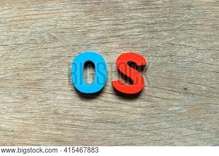 Color Alphabet Letter In Word Os (abbreviation Of Operating System) On Wood Background