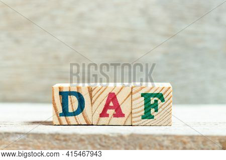 Alphabet Letter Block In Word Daf (abbreviation Of Delivered At Frontier) On Wood Background