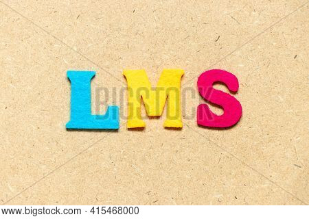 Color Cloth Alphabet Letter In Word Lms (abbreviation Of Learning Management System) On Wood Backgro