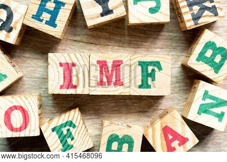 Alphabet Letter Block In Word Imf (abbreviation Of International Monetary Fund) With Another On Wood