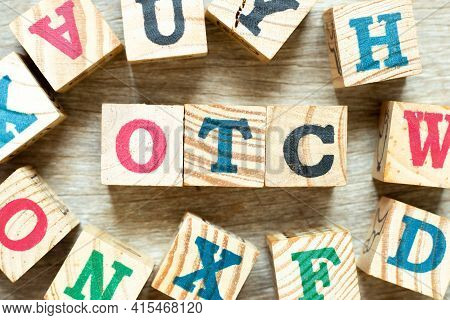 Alphabet Letter Block In Word Otc (abbreviation Of Over The Counter) With Another On Wood Background