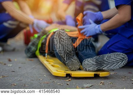 Selective Focus Shoe . Team Paramedic Firs Aid Accident On Road. Ambulance Emergency Service. First
