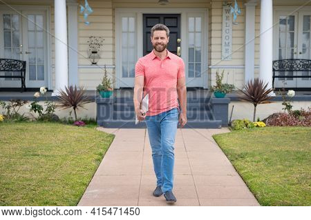 Confidence And Business Concept. Man Standing In Front Of His New Home. Buy, Sell, Real Estate, Prop