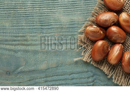Raw Jackfruit Seeds And Sackcloth On Light Blue Wooden Table, Flat Lay. Space For Text