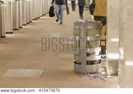 An Overflowing Trash Can Is Littered With Subway Tickets In The Metro In Russia.