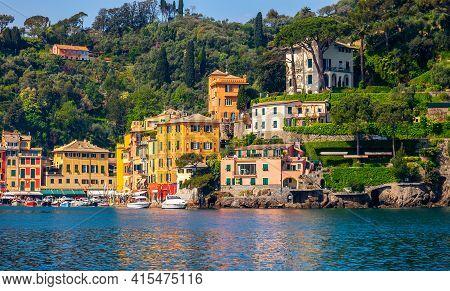 View Of Charming Characteristic Italian Village Of Portofino On Italian Riviera Of Liguria With Colo