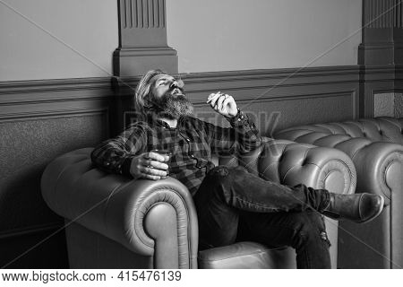 Male Club. Glass Whisky In Male Hand. Brutal Bearded Hipster Smoking Cigarette Drinking Alcohol Whil