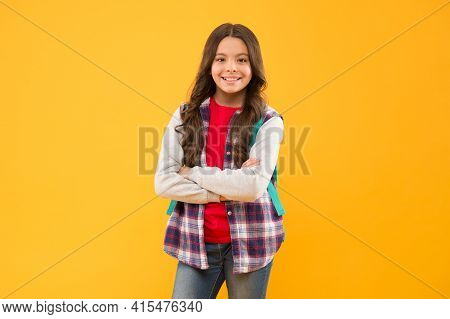 Confident Teenage School Girl Child Happy Smile Keeping Arms Crossed Yellow Background, Teenager
