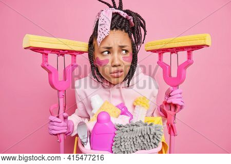 Ready For Big Cleaning Worried Displeased Afro American Woman Concentrated Aside Smirks Face From Di