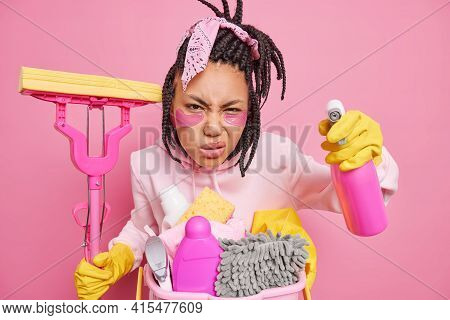 Photo Of Dissatisfied Housewife Poses With Housecleaner Tools Cares About Purity Smirks Face Looks S