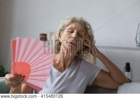 Mature Senior Woman Exhausted With Heat, Swelter, Summer Weather
