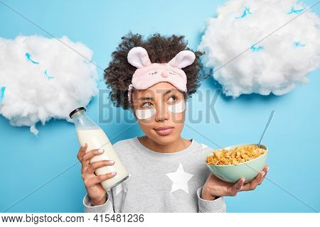 Thoughtful Millennial Girl Has Healthy Breakfast Holds Bowl Of Cornflakes And Milk Bottle Dressed In