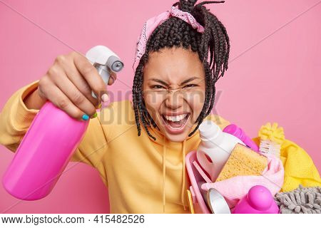 Annoyed Housekeeper Cleans Everything With Washing Detergent Holds Basket Full Of Cleaning Supplies