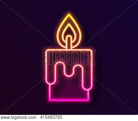 Glowing Neon Line Burning Candle Icon Isolated On Black Background. Cylindrical Candle Stick With Bu