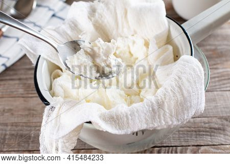 Frozen Dairy Products. Frozen Sour Cream. Frozen Yogurt On A Wooden Table