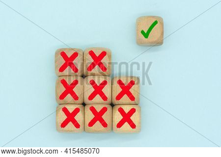 The Check Mark Symbol On A Wooden Cube Stack With Wrong Or Cross Icon. Making A Right Decision After