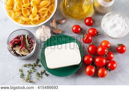 Preparation Of Ingredients For Feta Pasta. Trending Feta Bake Pasta Recipe Made Of Cherry Tomatoes,